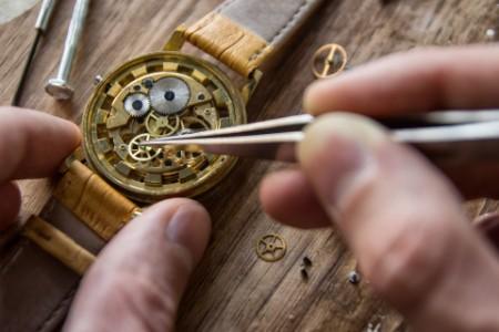 Watch repairer working on watch