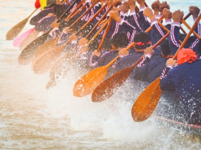 Close-up of rowing team race