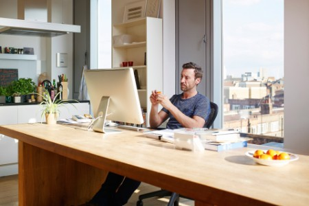 Man working at desk in apartment