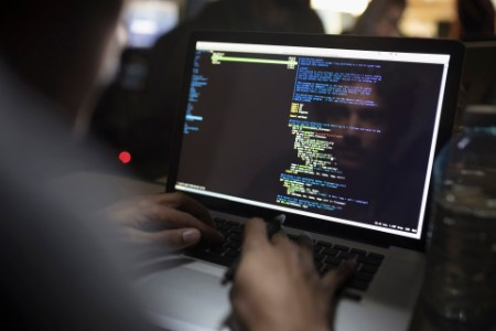 Reflection male hacker coding laptop