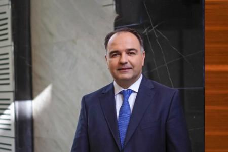 Profile portrait of Vassilios Kaminaris