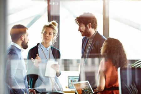 Men and women talking in modern office