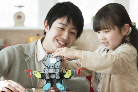 Parent and child assembling a robot