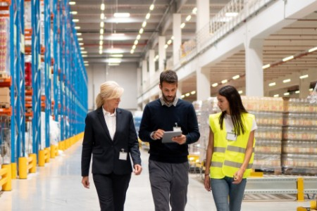 Managers visiting warehouse