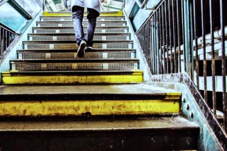 A Man Climbing Steps