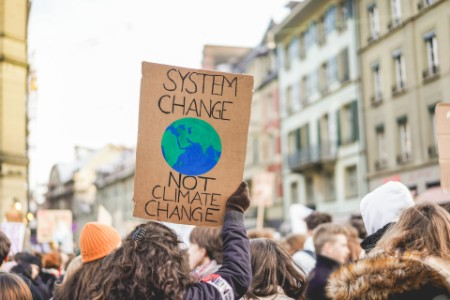 Group of demonstrators on road, young people fight for climate change