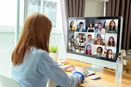 Business people working remotely via video conference
