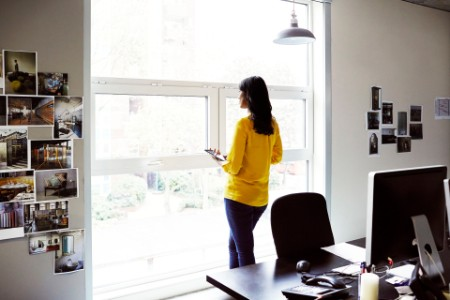 Female office worker looking out of a window