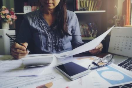 Accountant using calculator on Budget 2022