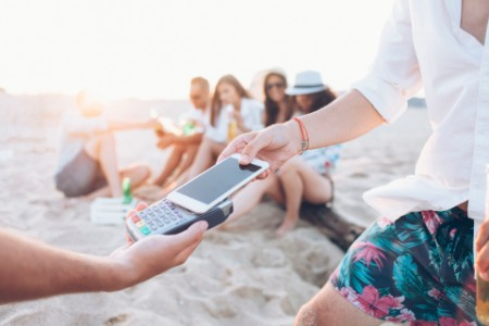 Using smart phone for paying on beach