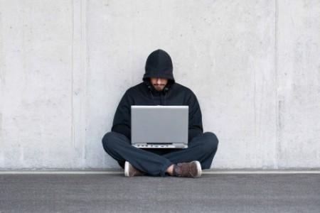 Men doing something on his laptop