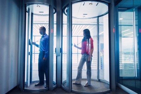 Business people using fingerprint lock system in office