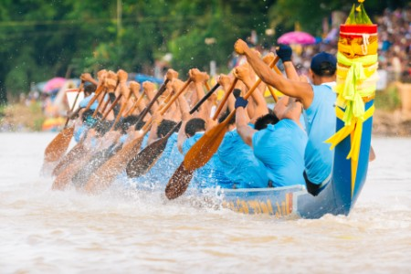 Closeup of rowing team in race