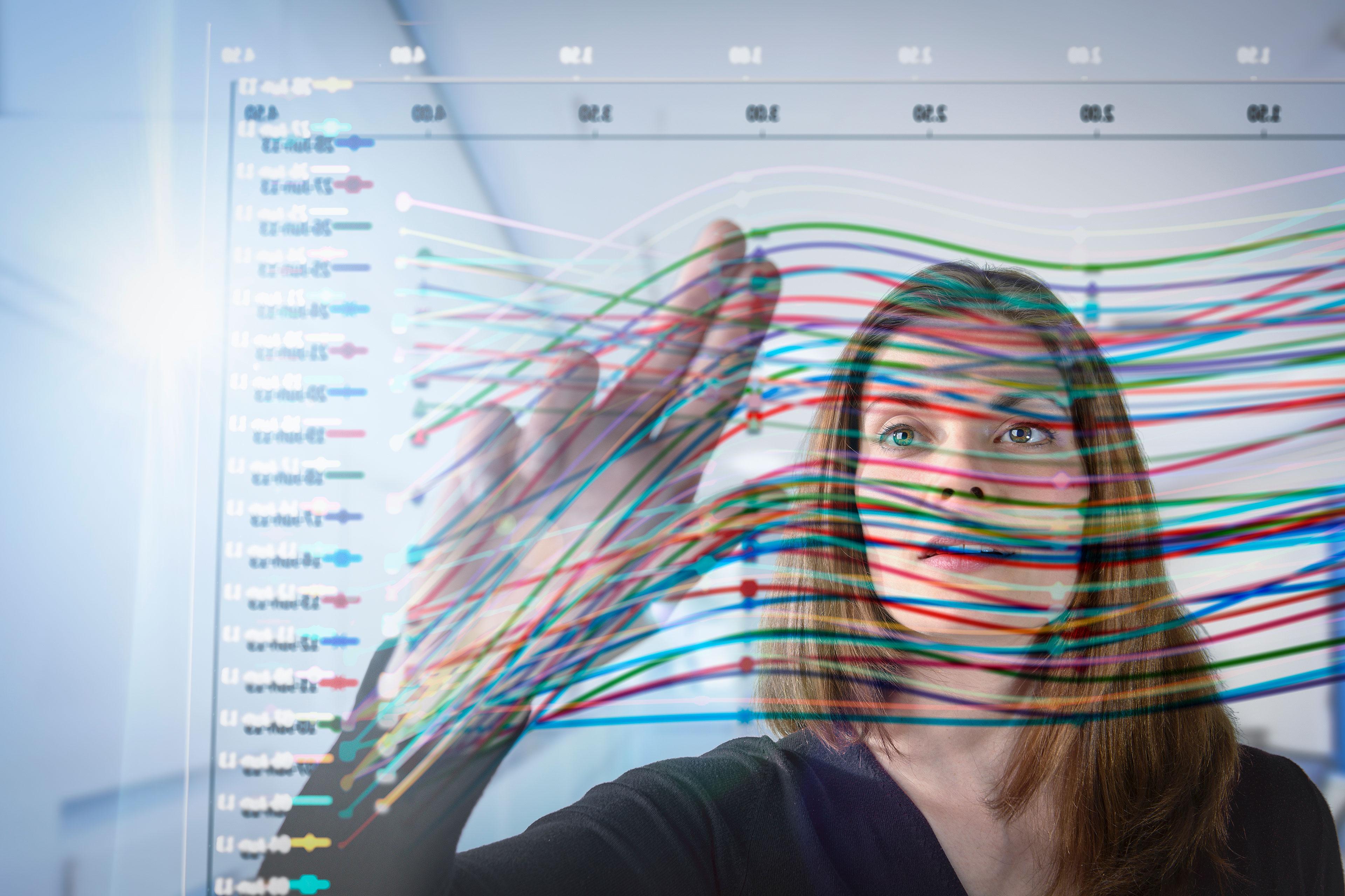 EY - Businesswoman using interactive screen