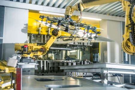 Car parts handled by robots in car factory
