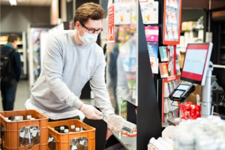 Man wearing face mask grocery shopping