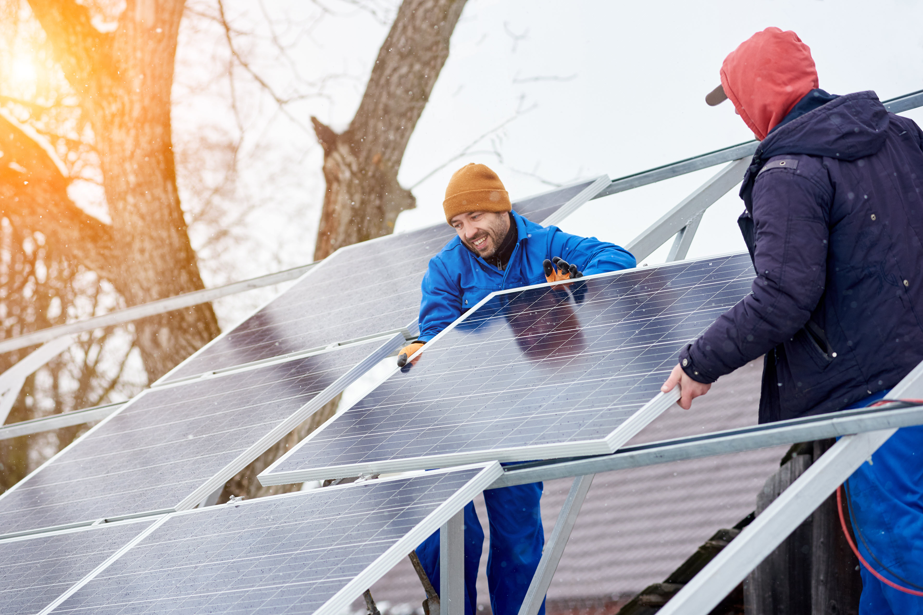 two people installing solar panels