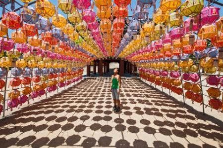 ey-woman-standing-under-chinese-lanterns