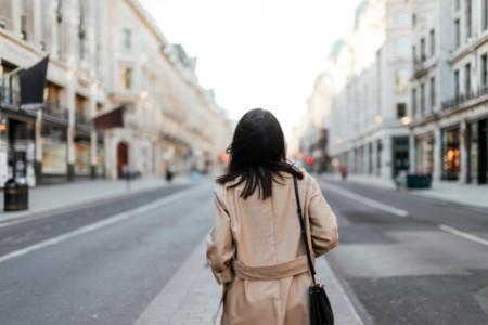 Woman walking down an empty street in London