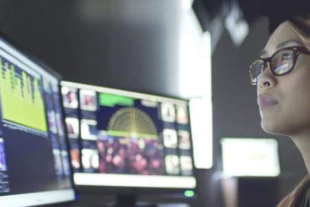 Woman analyzing data on screen