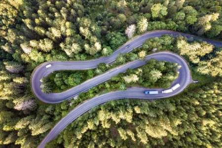 Aerial view of winding road in high mountain