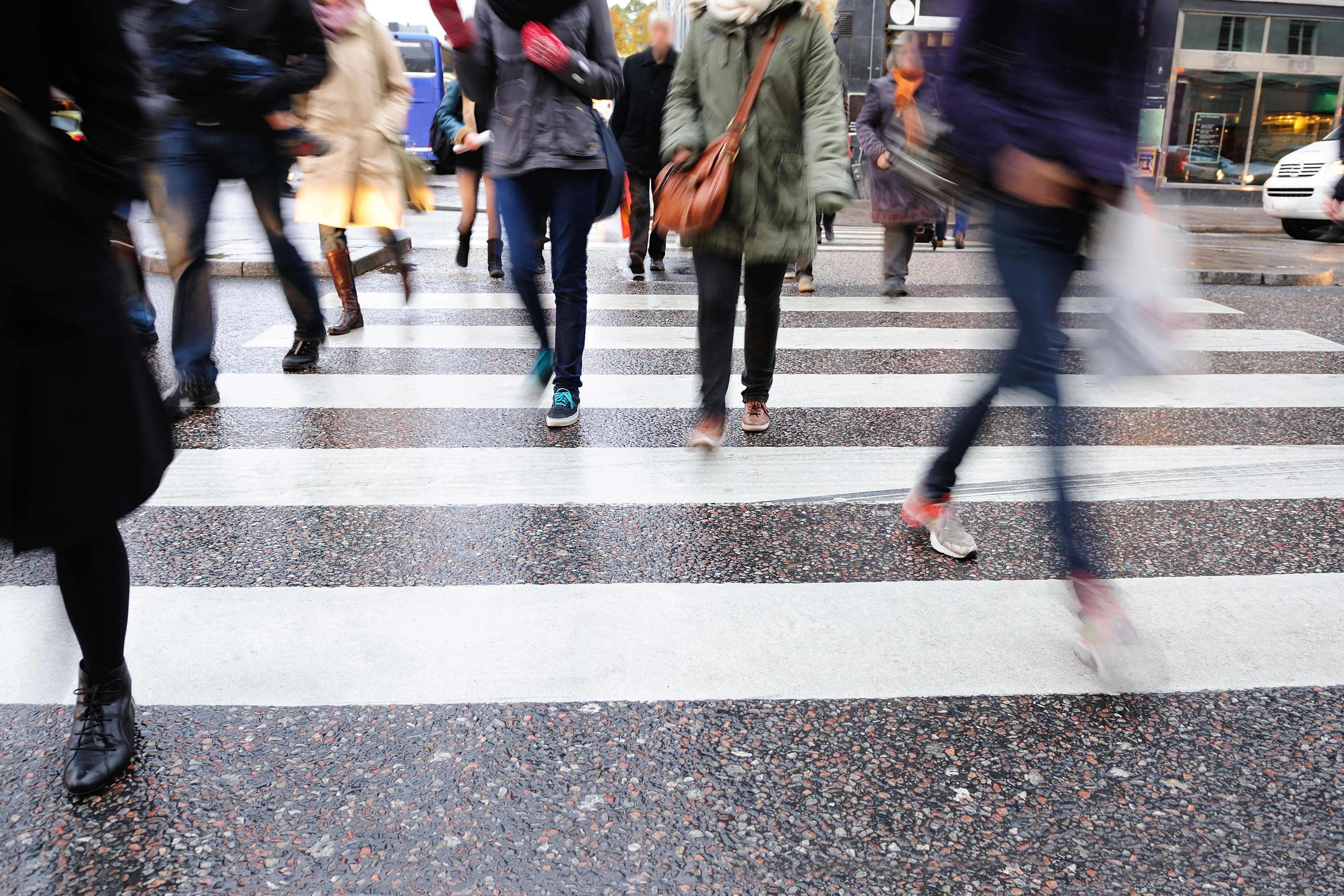 EY - Crowd using pedestrian crossing