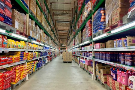 Warehouse isle with household products stacked on either side