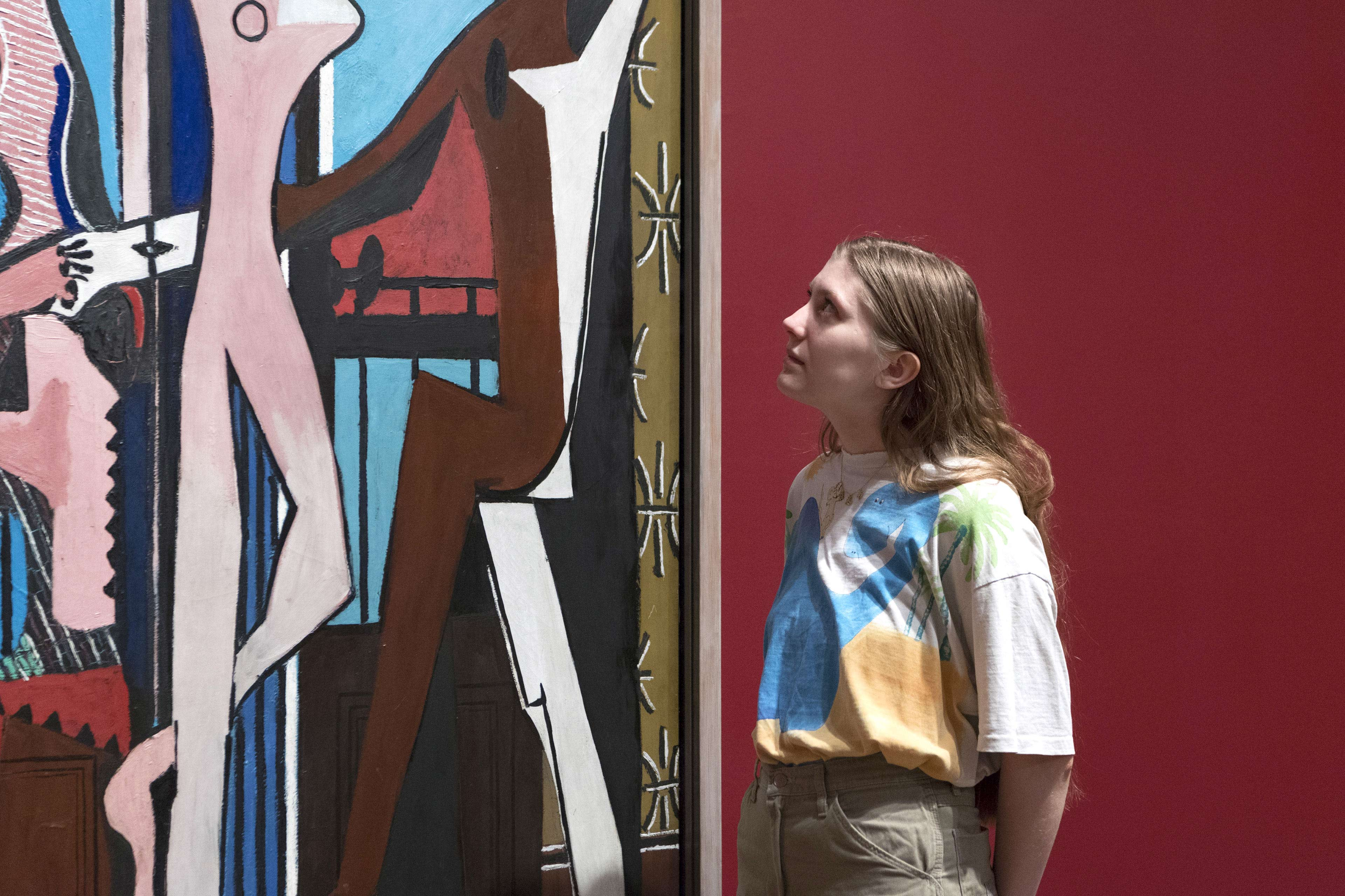 EY Woman Looking at a Painting by Picasso