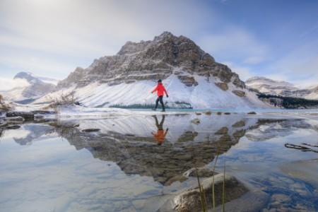 Men walking At Bow lake, Canada