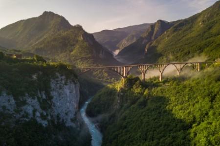 Beautiful misty morning view of Djurdjevica bridge