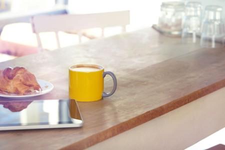 digital-tablet-and-coffee-mug