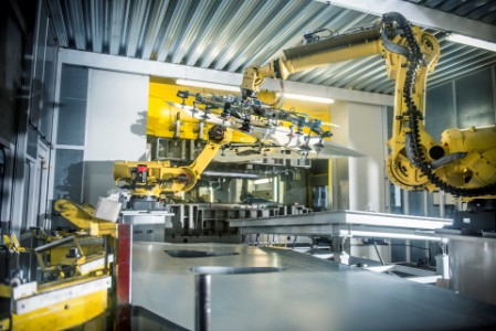 EY - Yellow mechanical arm in factory production line