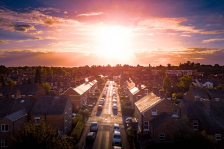 Residential street at sunrise seen from above