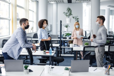 young-professionals-in-office-wearing-covid-19-masks