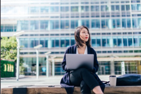 Businesswoman using tablet in financial services