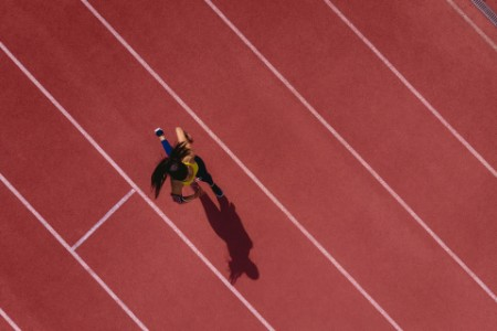woman-running-on-race-track-ipo