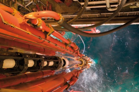 Oil rig view riser pipes down sea level