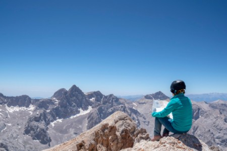 Person sitting on top of a mountain