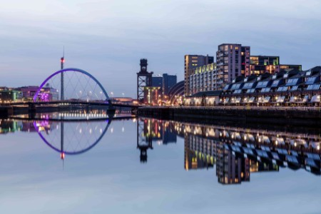 The Clyde Arc Bridge at night across the River Clyde West of Glasgow city centre in the Finnieston area. The bridge is also known locally as the Squinty Bridge because of the angle at which it crosses the river
