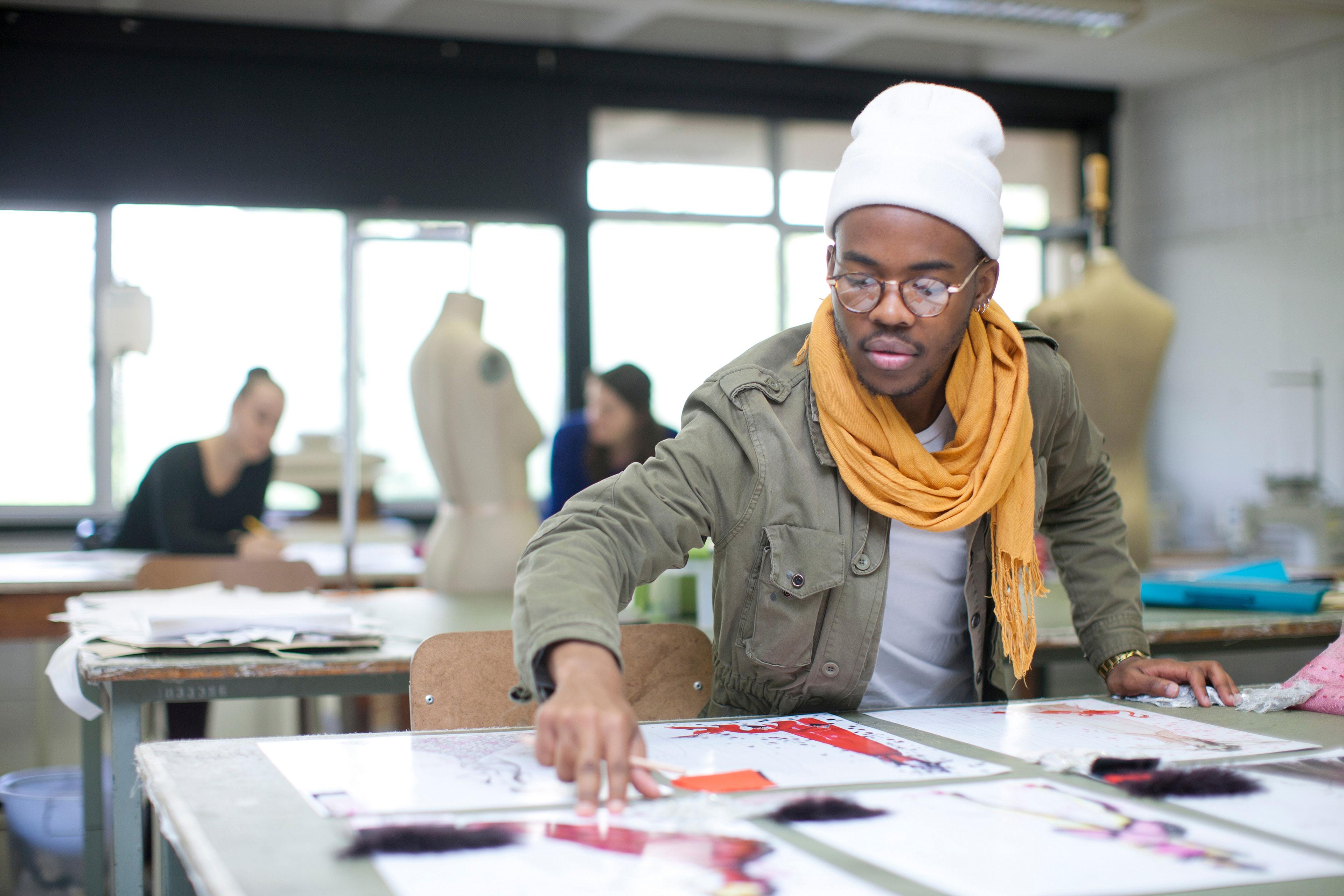 EY - Designer working in studio