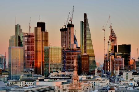 View of city skyscrapers in at sunset