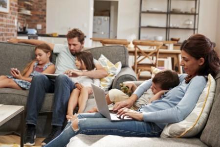 Family sitting in living room