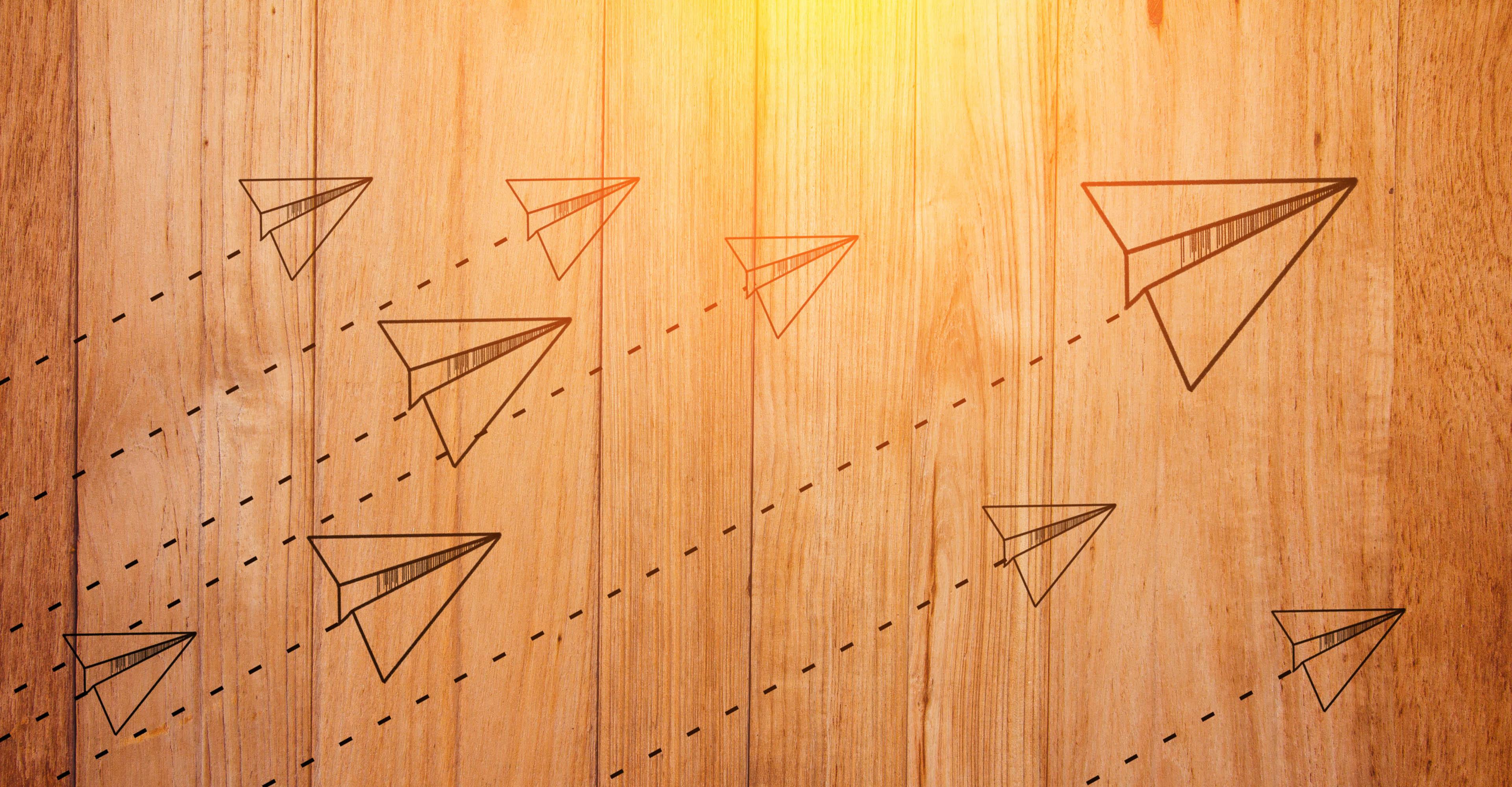 Rocket paper doodleon wooden background