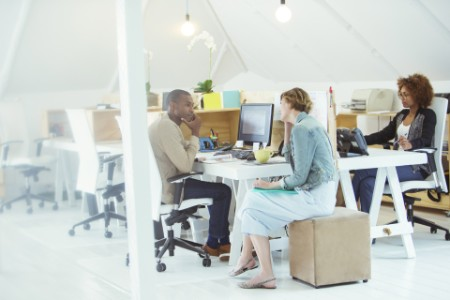 Two employees having a conversation in an office