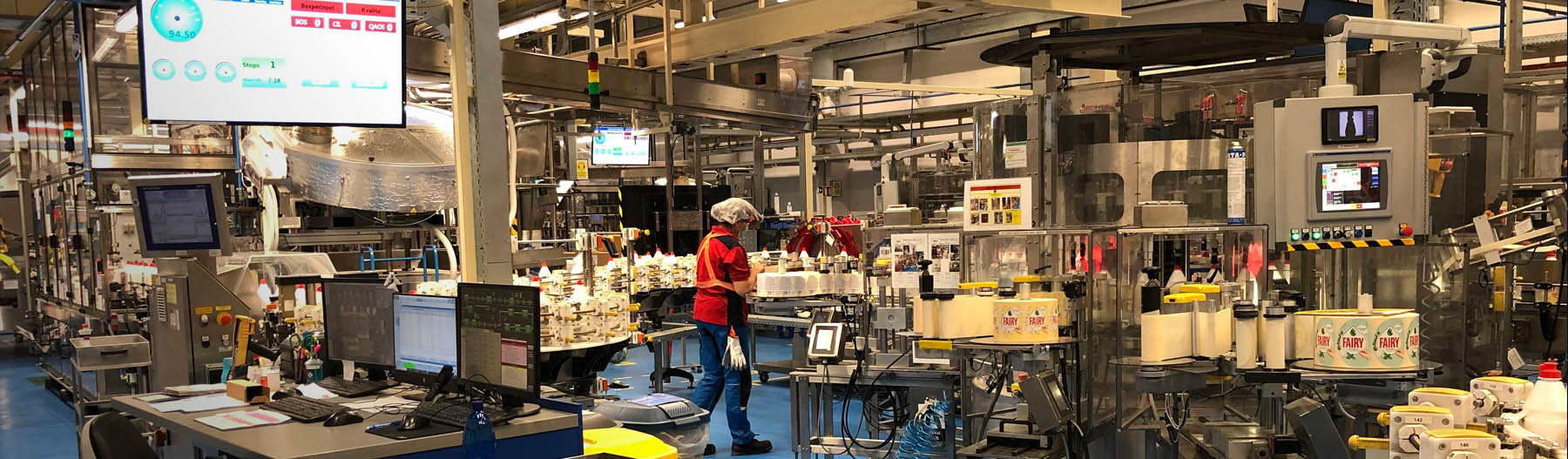 EY - A worker is seen on the dish packing line