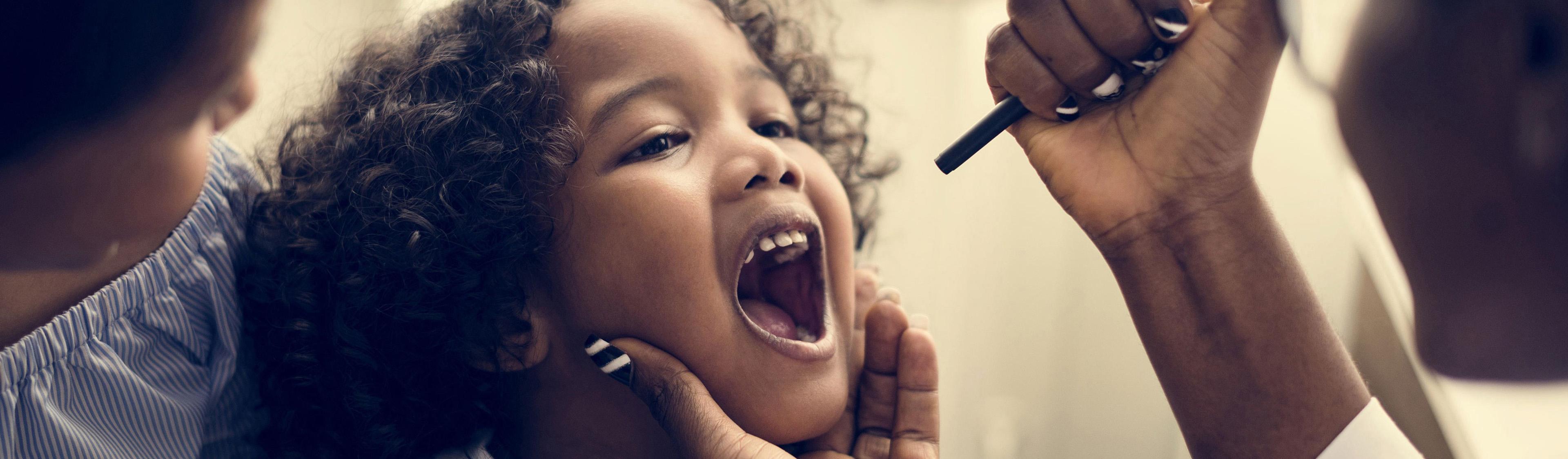 EY - Little girl having her teeth checked
