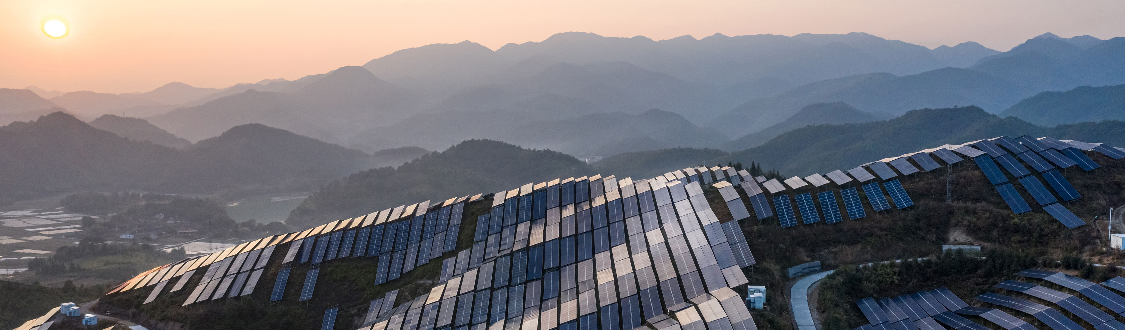 EY - Solar power plant on the top of the mountain at sunset