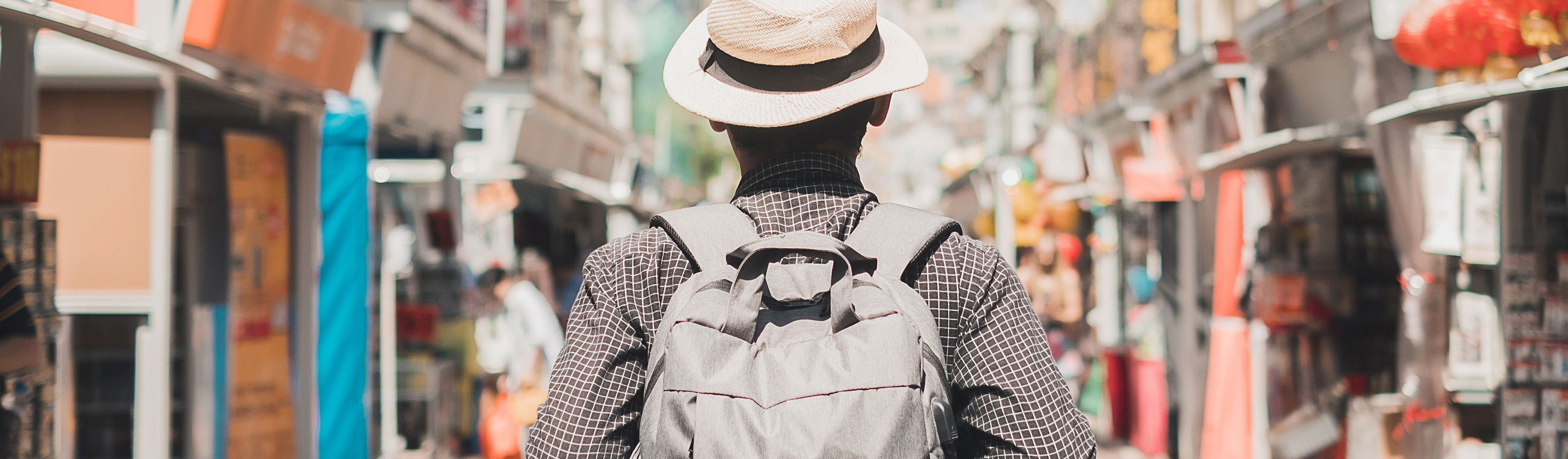 Young man traveling with backpack and hat