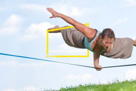 woman doing yoga on a tension line