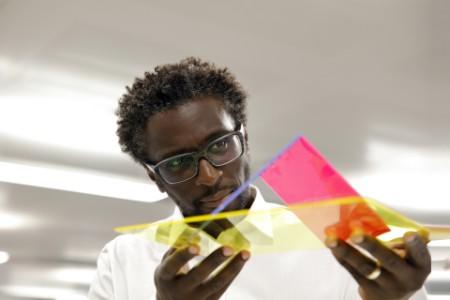 Designer examining a prototype